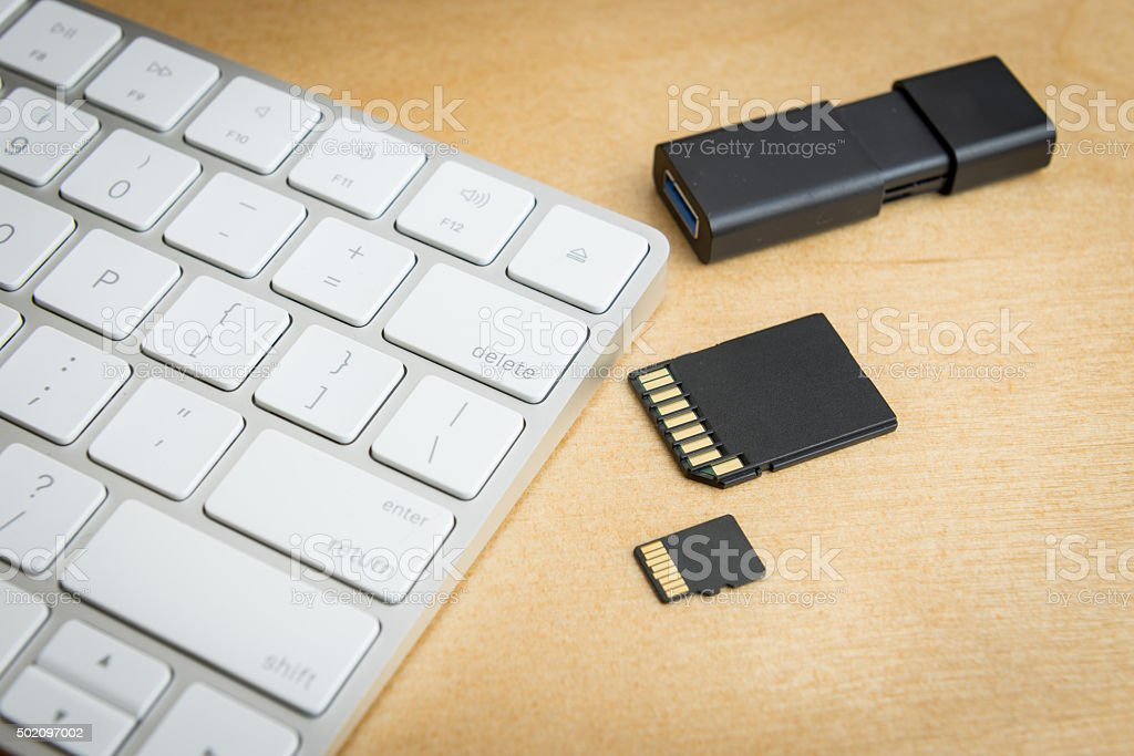 wireless keyboard and memory storages stock photo