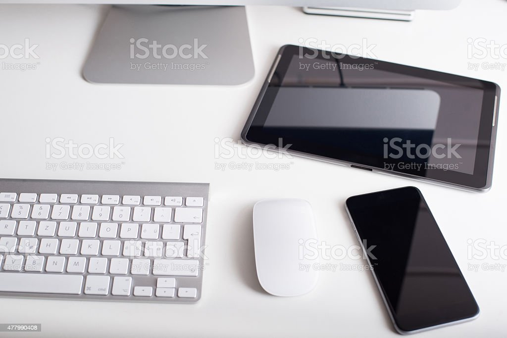 Wireless keyboard, mouse, tablet and smartphone stock photo