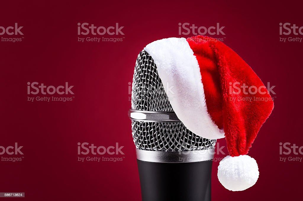 Wireless microphone with santa hat on it stock photo