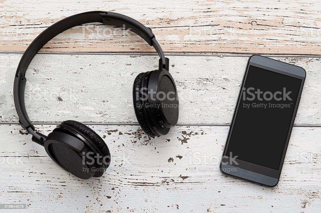 Wireless modern head phones and smart phone stock photo