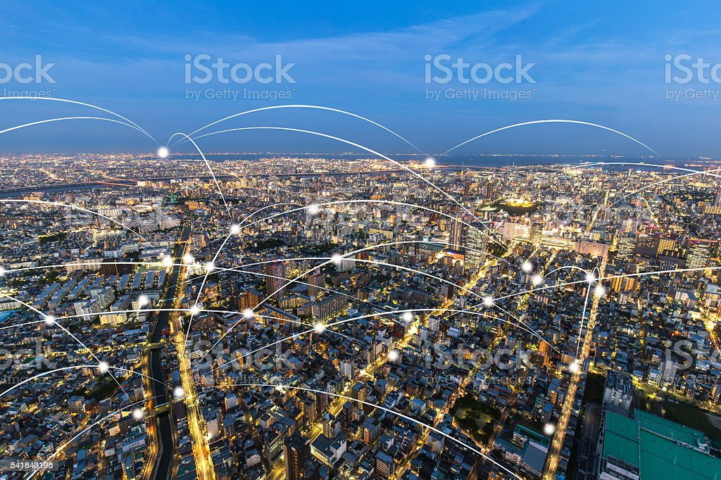 wireless signal over cityscape and skyline of tokyo at twilight stock photo