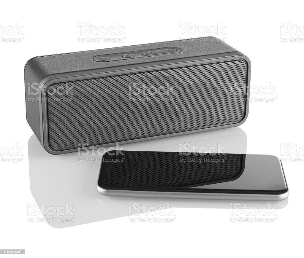 Wireless speaker and mobile phone stock photo