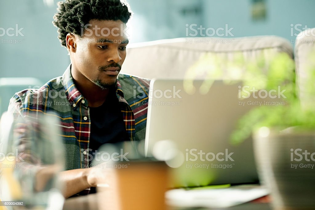 Wireless technology allows him to work on his own terms stock photo