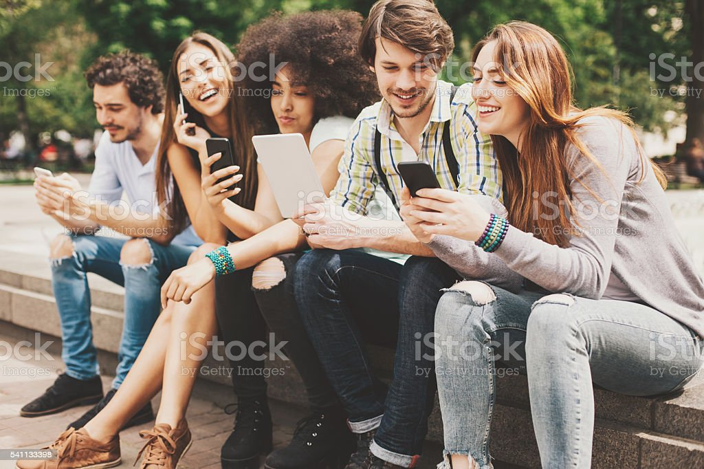 Wireless technology and young people stock photo