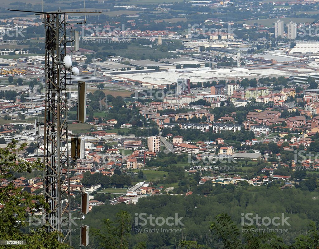 wireless telecommunications antenna over the immense metropolis stock photo