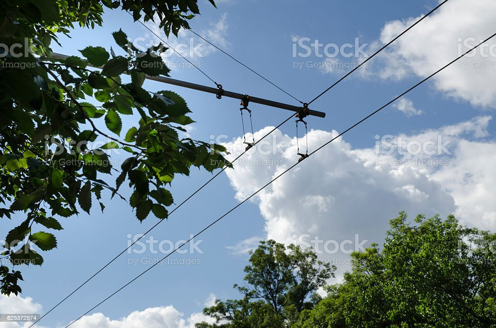 Wires of trolley bus in a sunny day stock photo