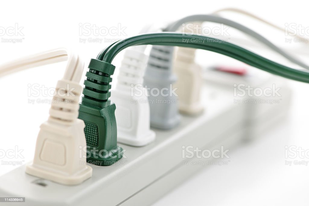 Wires plugged into power bar strip stock photo