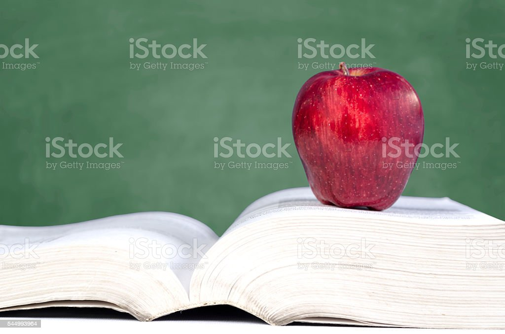wisdom - Apple on book stock photo