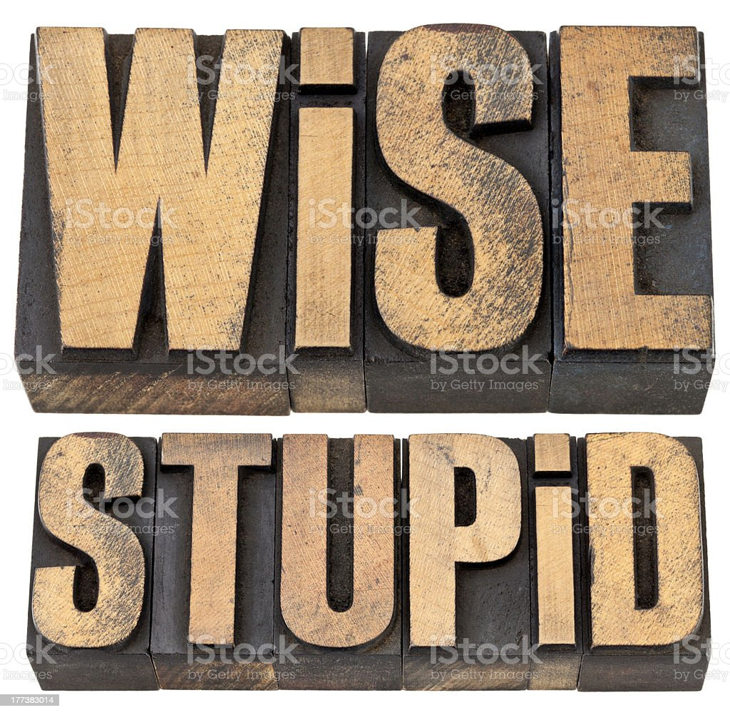 wise and stupid in letterpress wood type stock photo