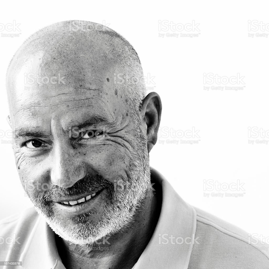A wise bald happy man posing for a photo royalty-free stock photo