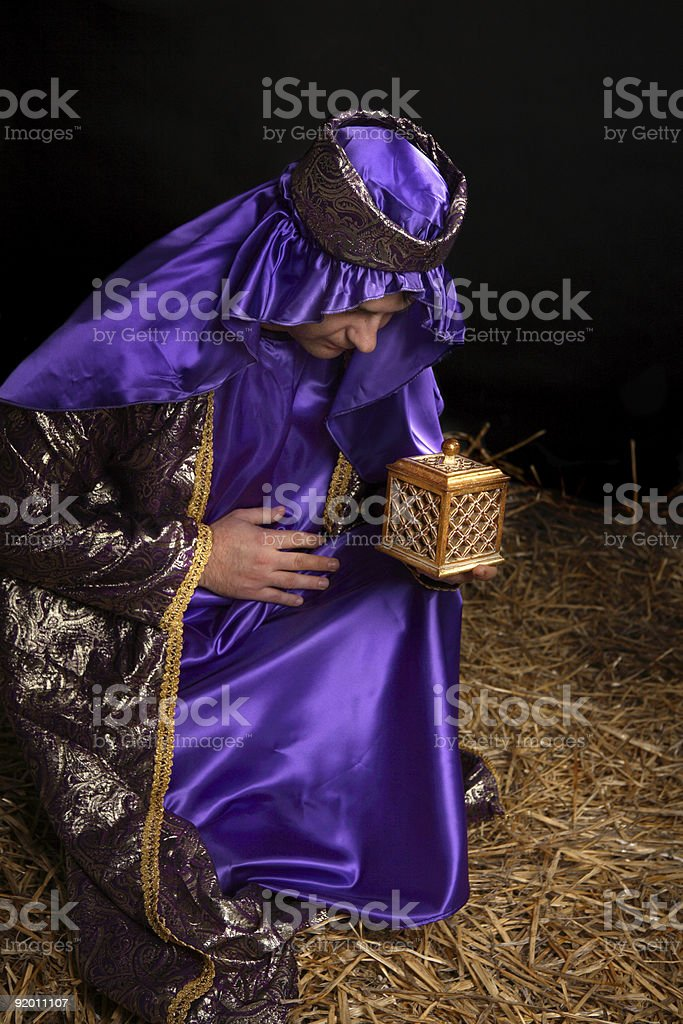 Wise man bowing and holding gift stock photo