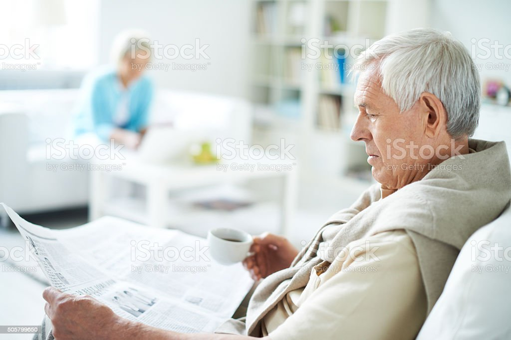 Wise senior man stock photo