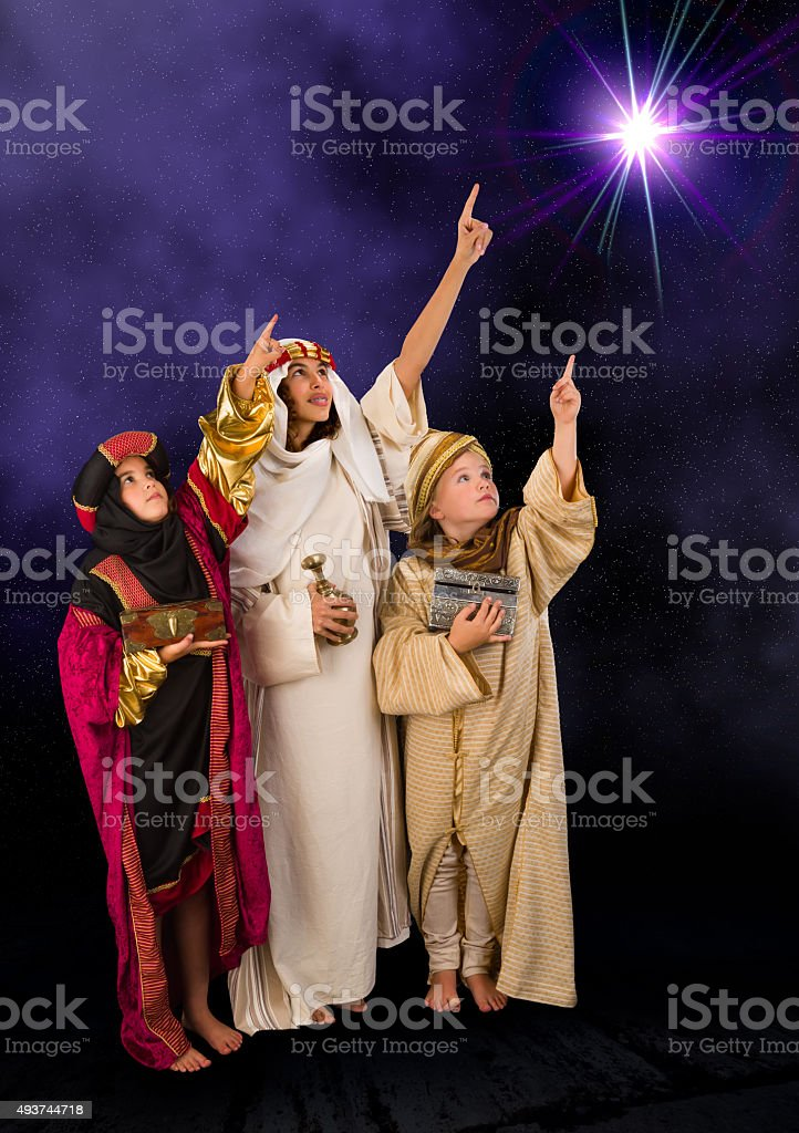 Wisemen watching christmas star stock photo
