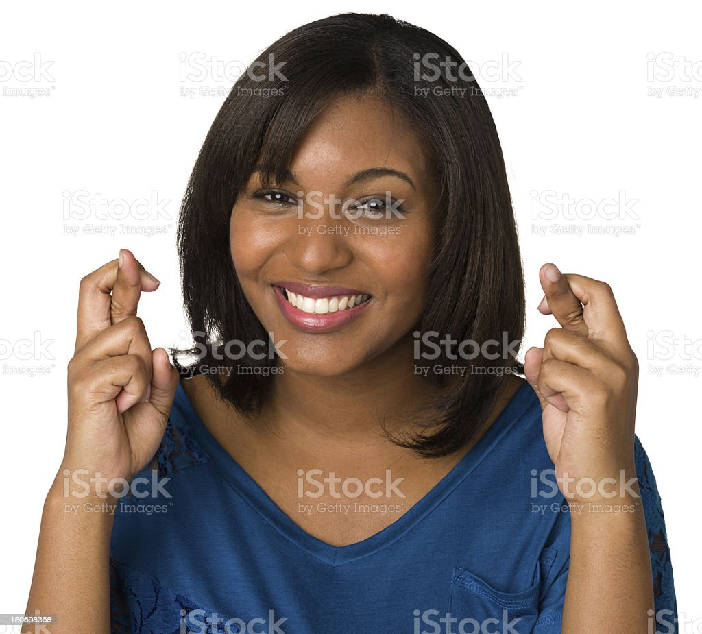 Wishful Young Woman Crosses Fingers royalty-free stock photo