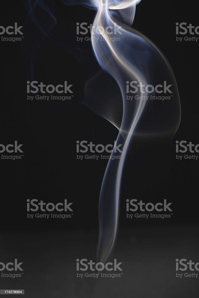 wisp of smoke stock photo