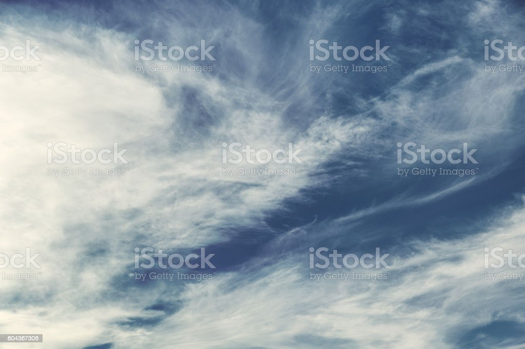 Wispy Cirrus Clouds in a Blue Sky stock photo