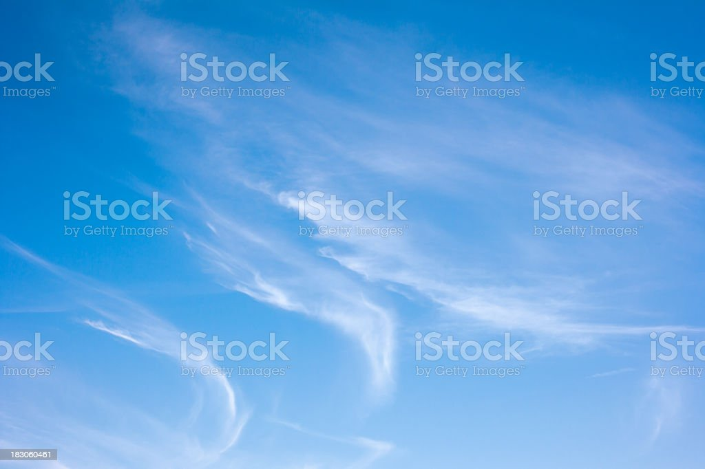 Wispy cirrus clouds on a clear day stock photo
