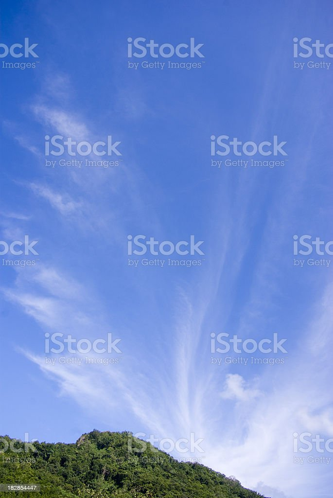 Wispy clouds and scenic blue sky stock photo