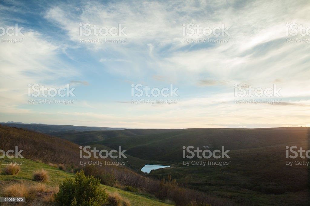 Wispy clouds over Gondwana Game Reserve hills stock photo