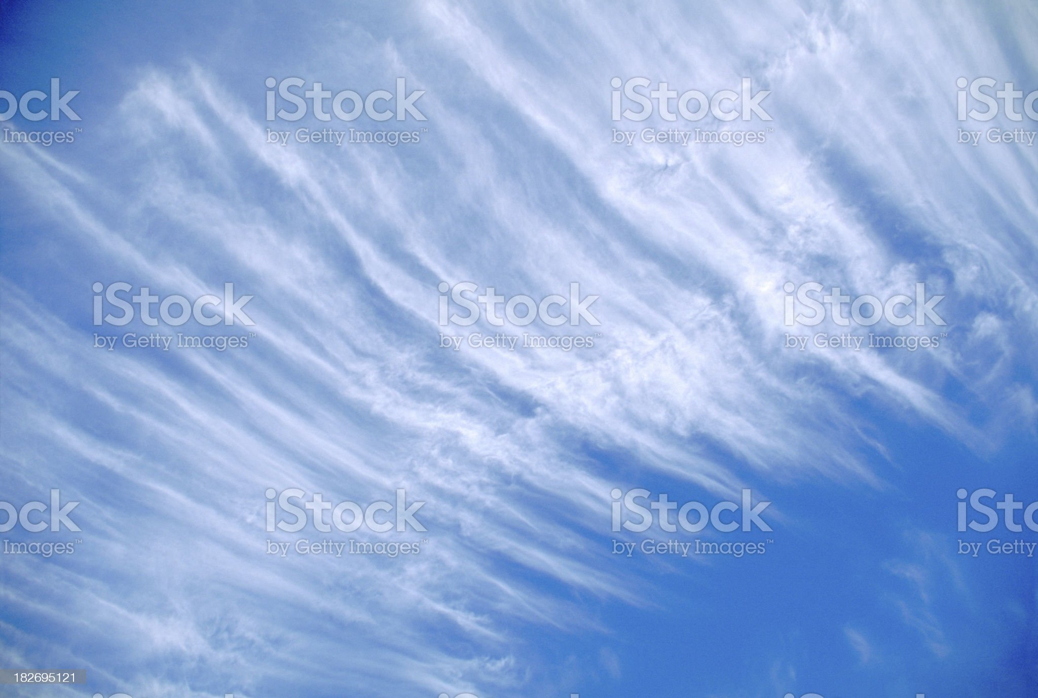Wispy Cool Clouds in Blue Sky royalty-free stock photo