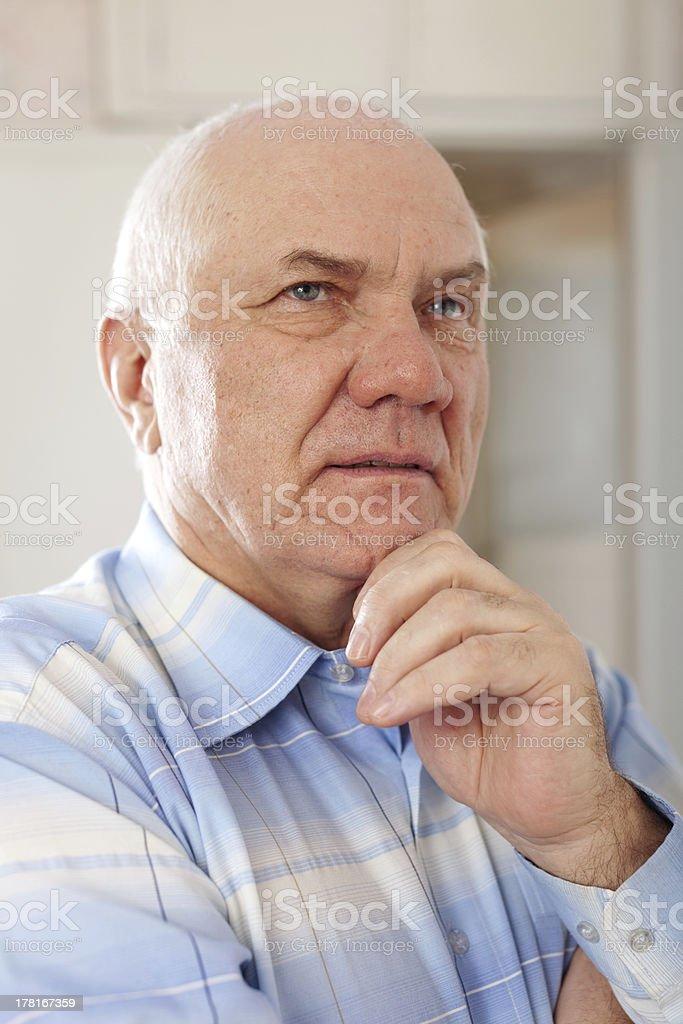 wistful senior man royalty-free stock photo