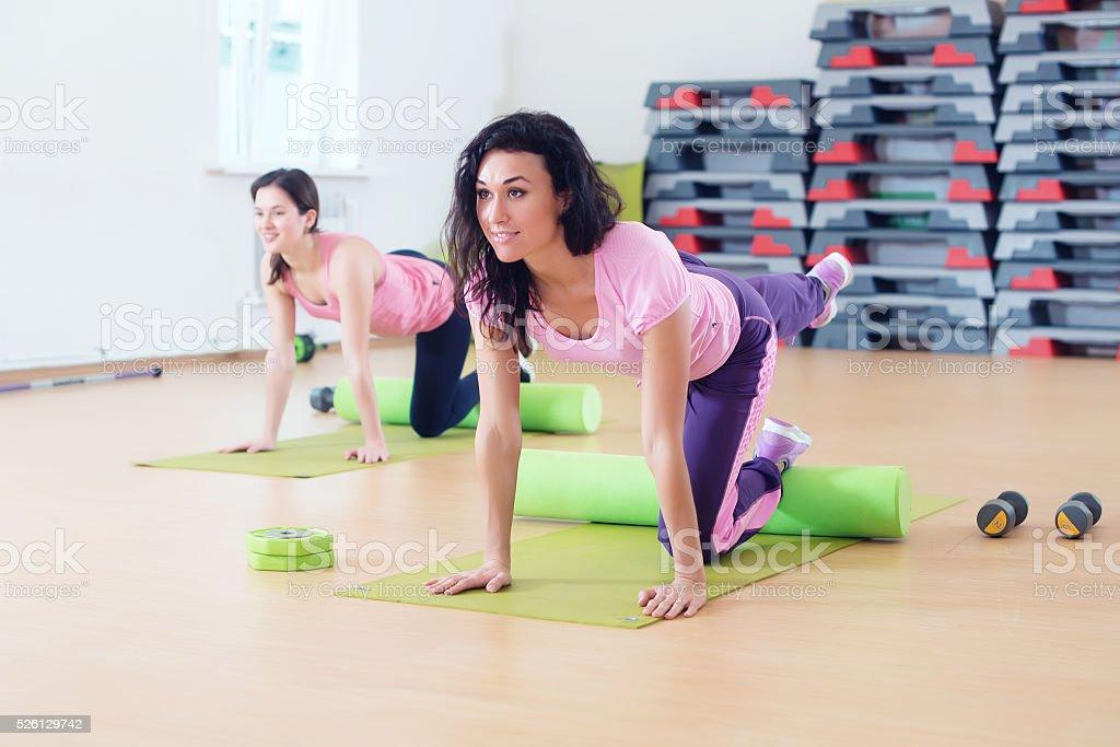 Wit women one leg extension kneeling kickbacks, exercise for lower stock photo