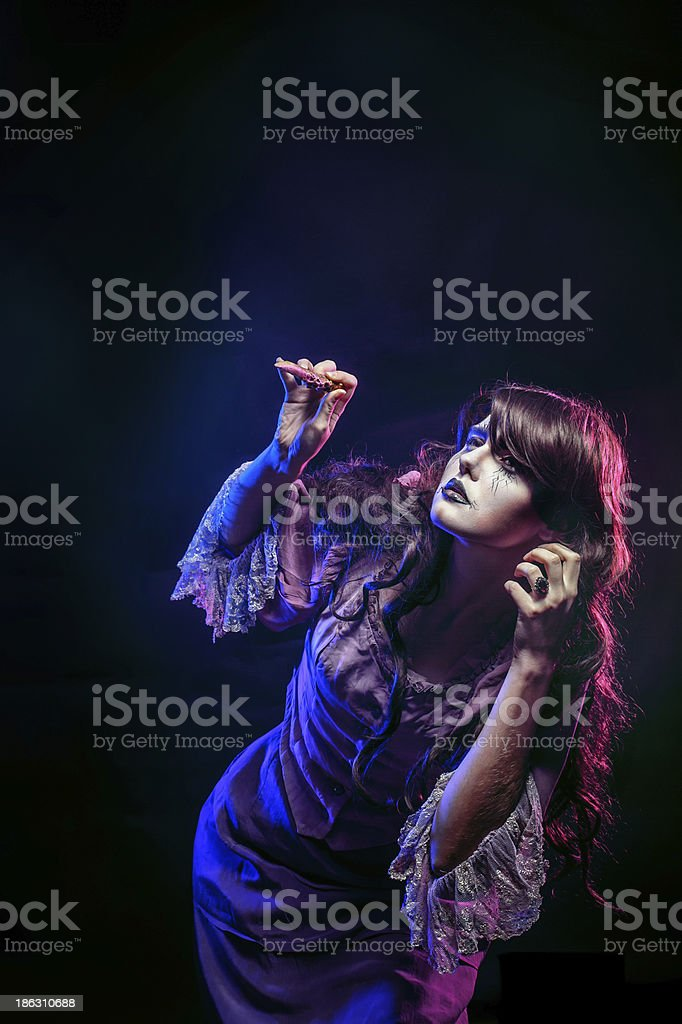 Witch and the magic wand stock photo