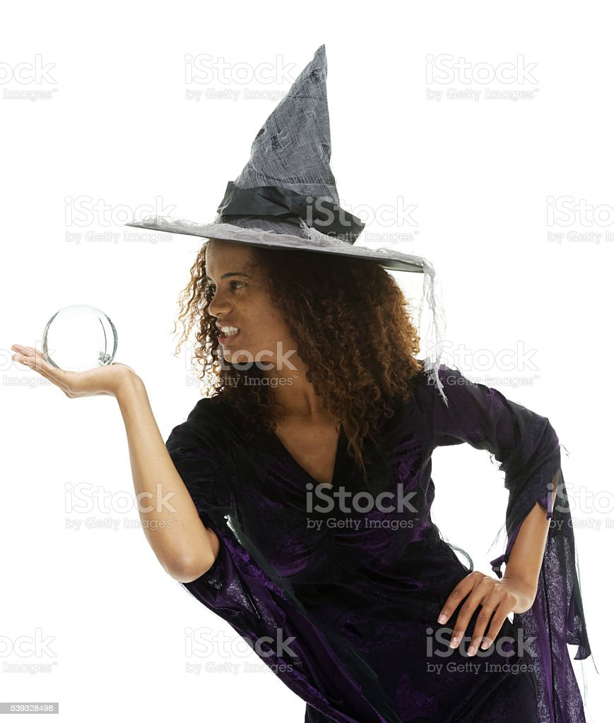 Witch holding crystal ball stock photo