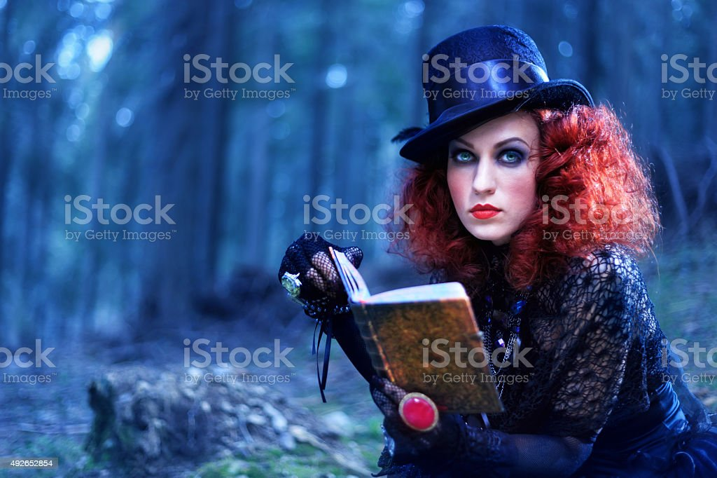 Witch in the forest. Halloween theme stock photo