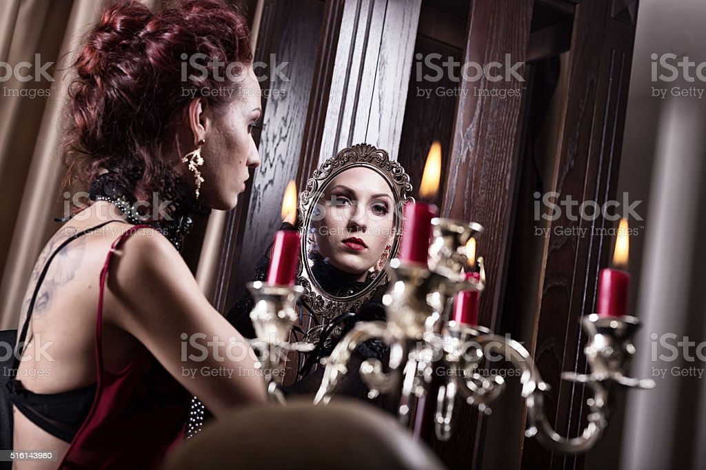 Witch In The Mirror  . Halloween theme stock photo