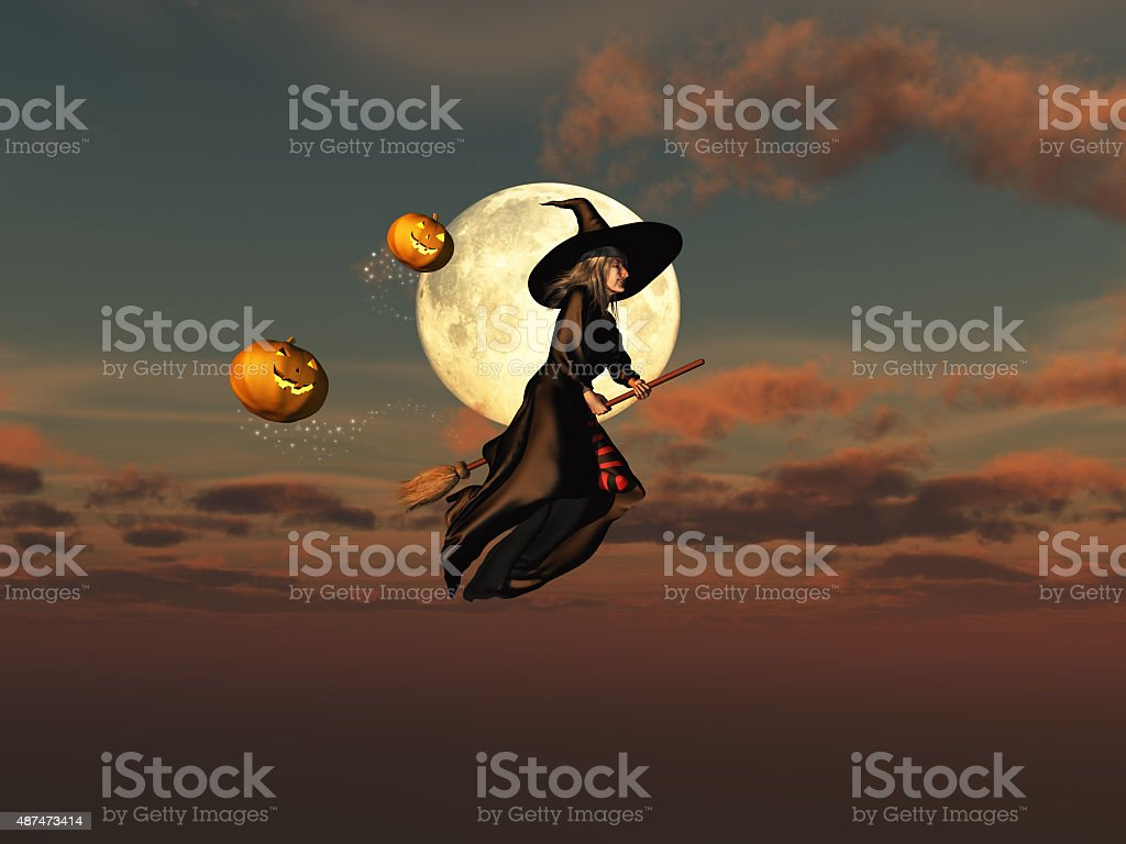 Witch on a broomstick and jack-o'-lanterns stock photo