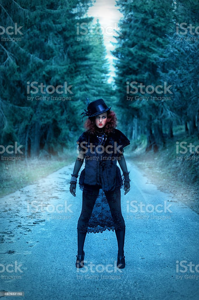 Witch on the road. Halloween theme stock photo