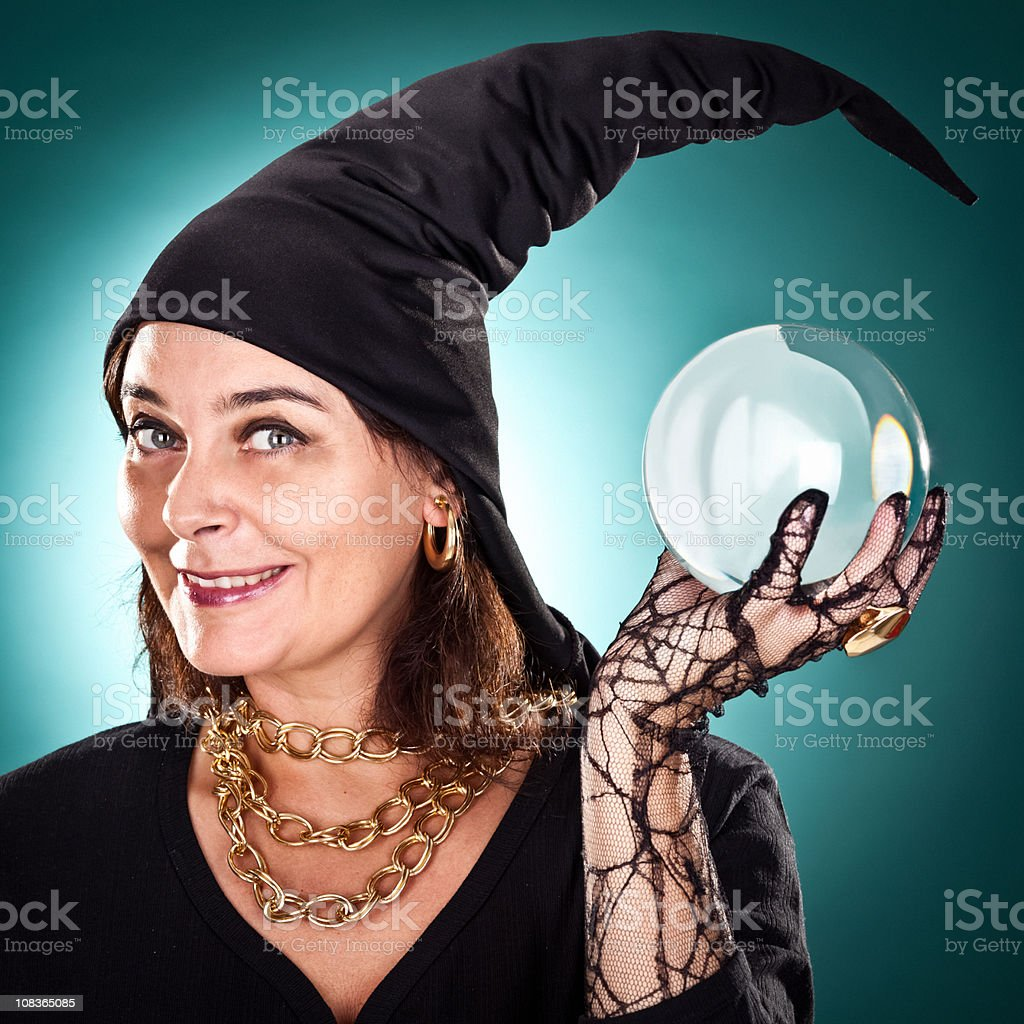 witch or sorceress smile with hat and crystal ball stock photo