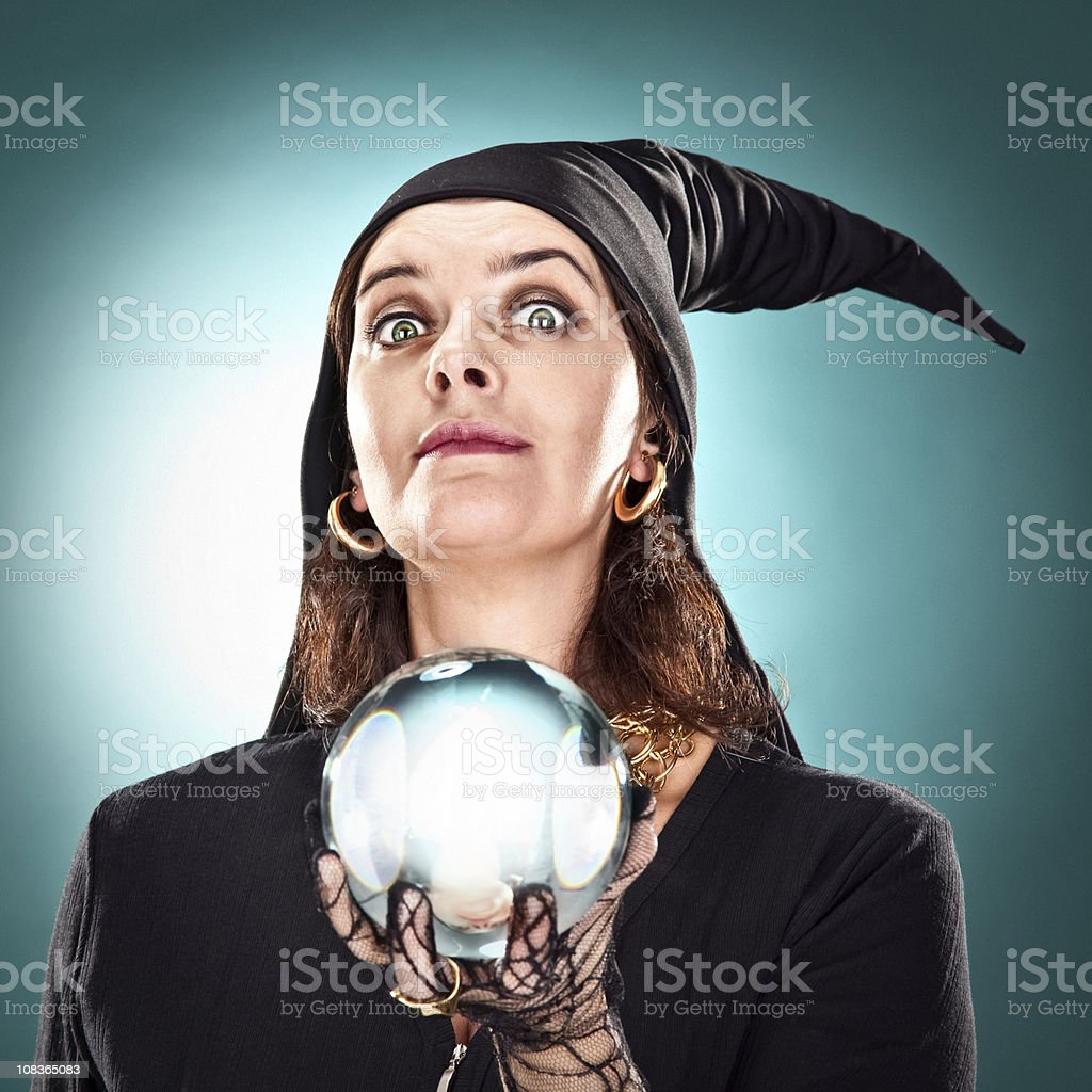 witch or sorceress with hat and crystal ball stock photo