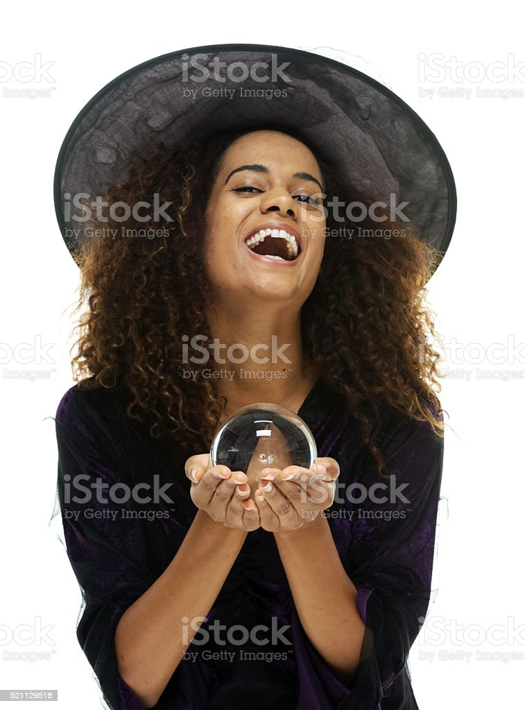 Witch posing with crystal ball stock photo