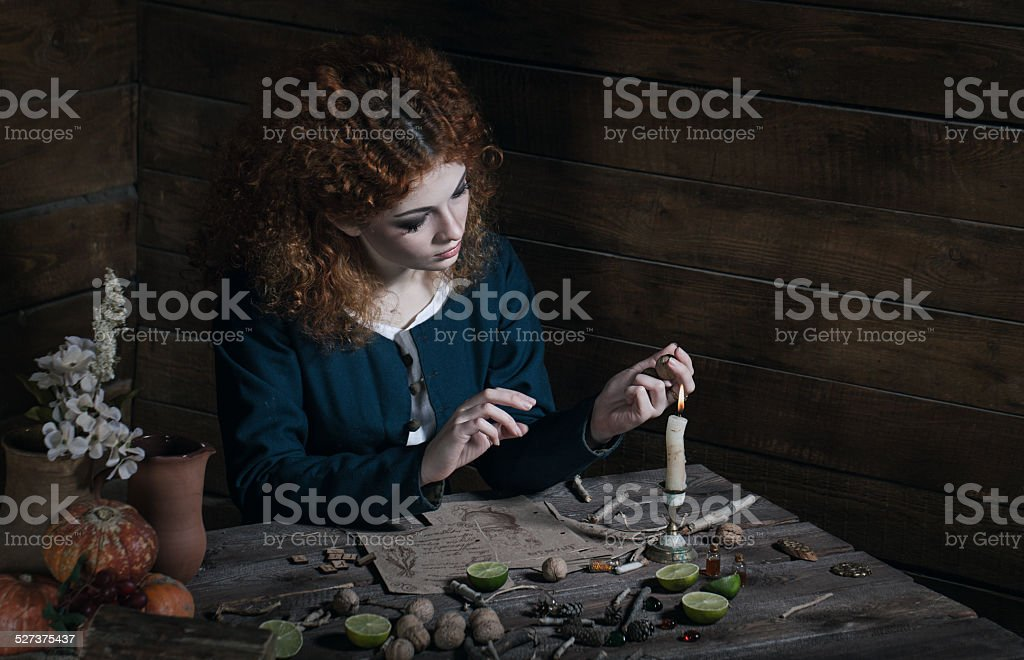 Witch preparing potion stock photo