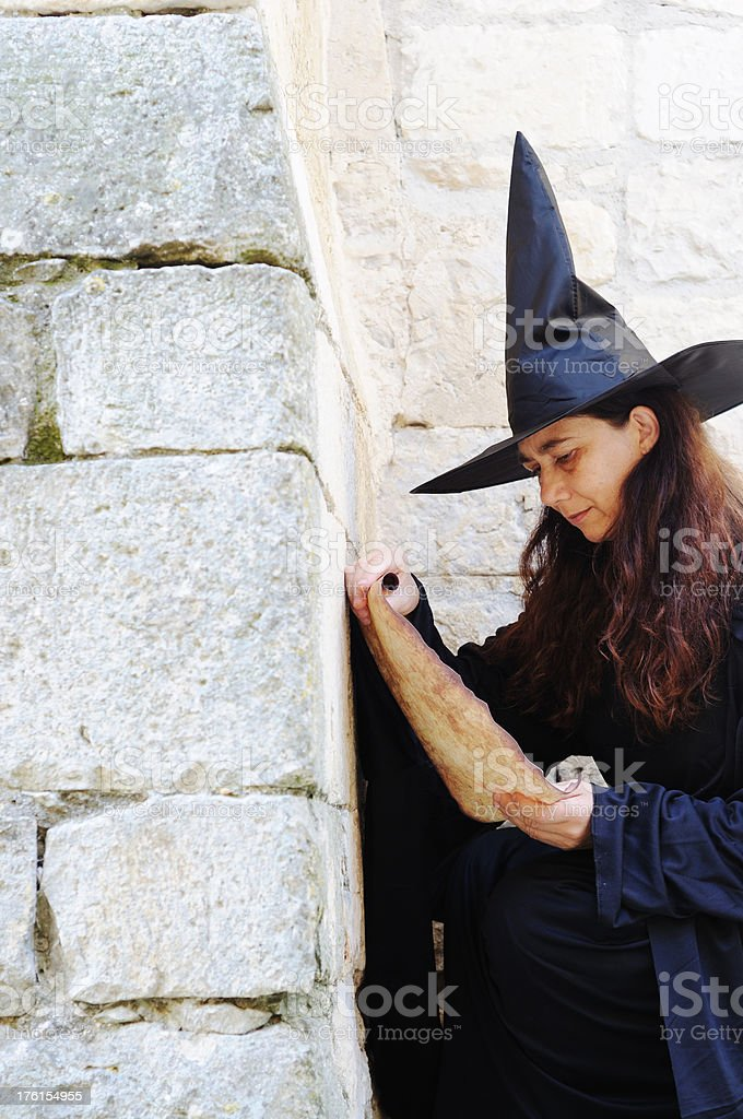 Witch reading spell stock photo