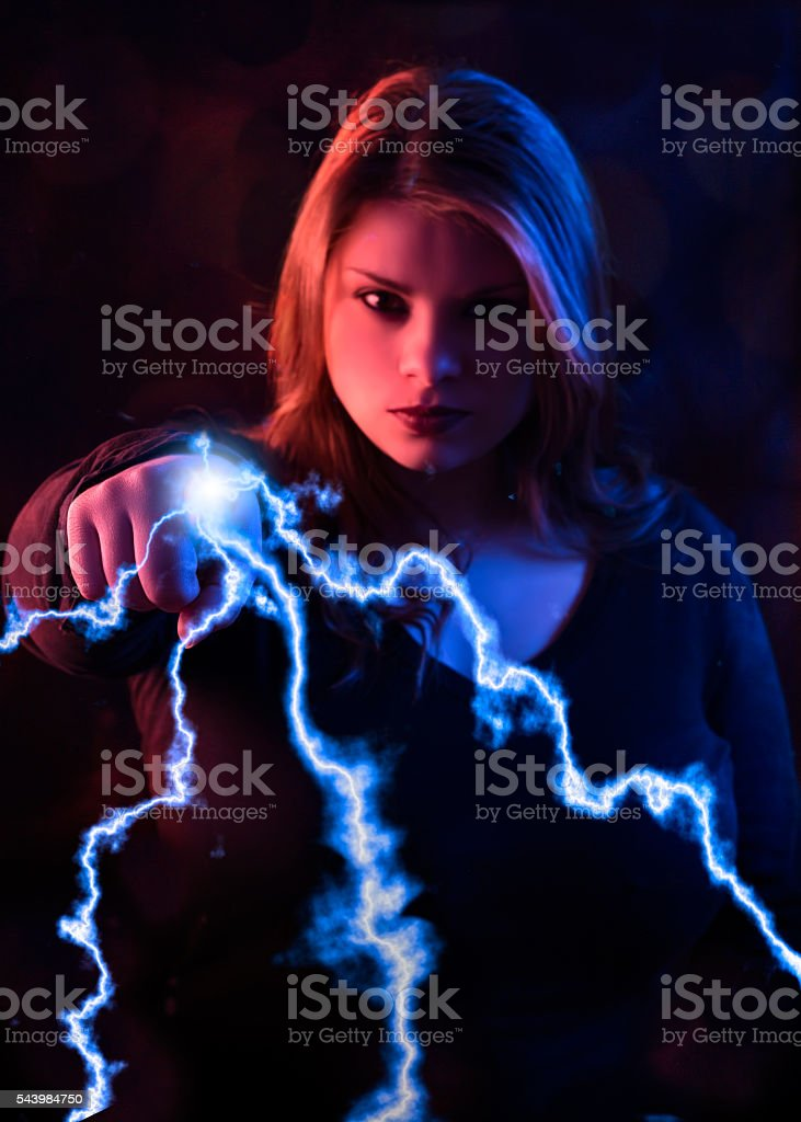Witch strikes with fingers stock photo