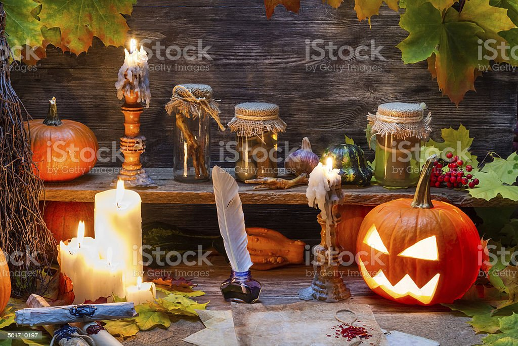Witch table with halloween pumpkin royalty-free stock photo