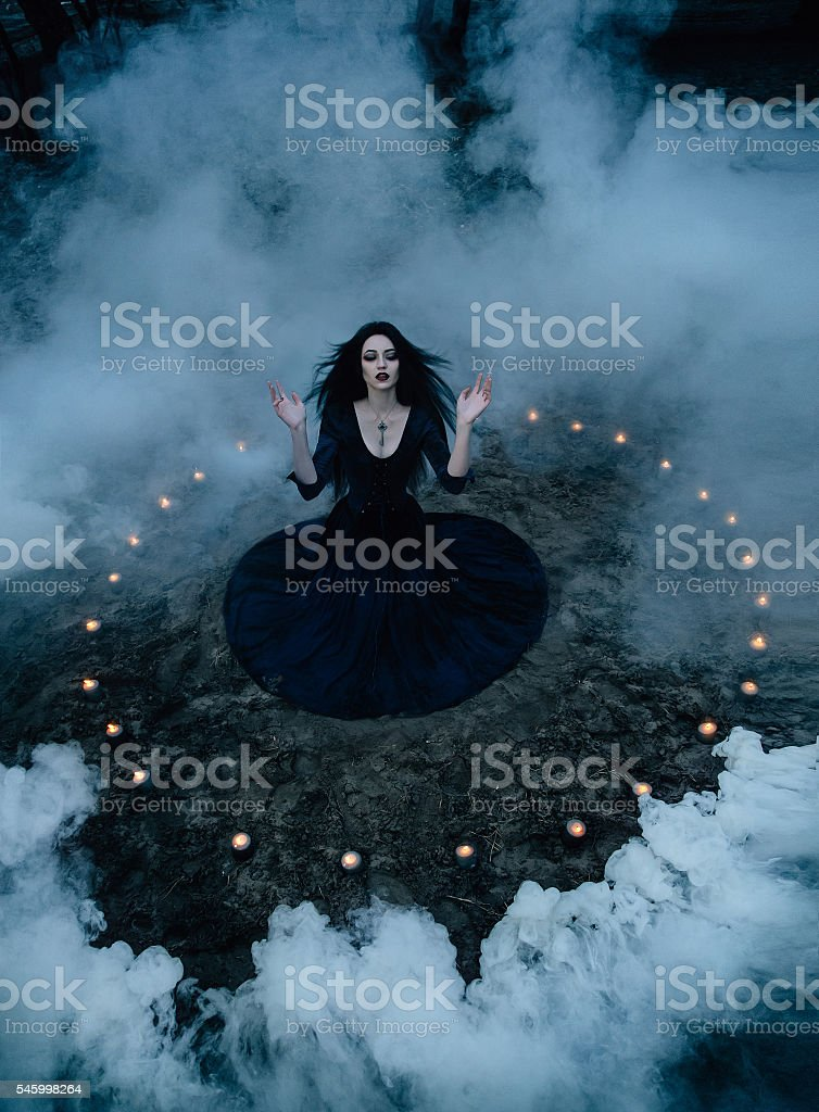 witch to conjure and decided stock photo