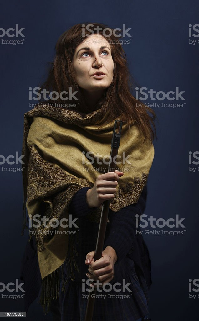 Witch with a broom stock photo