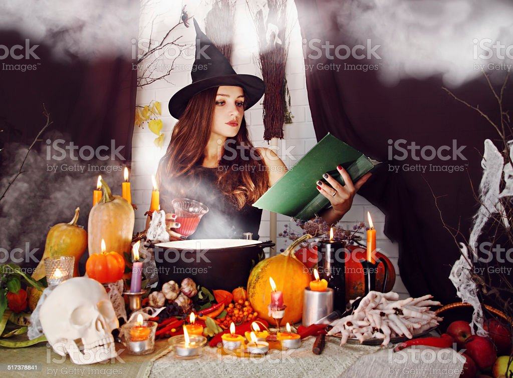 witch with a glass of blood stock photo