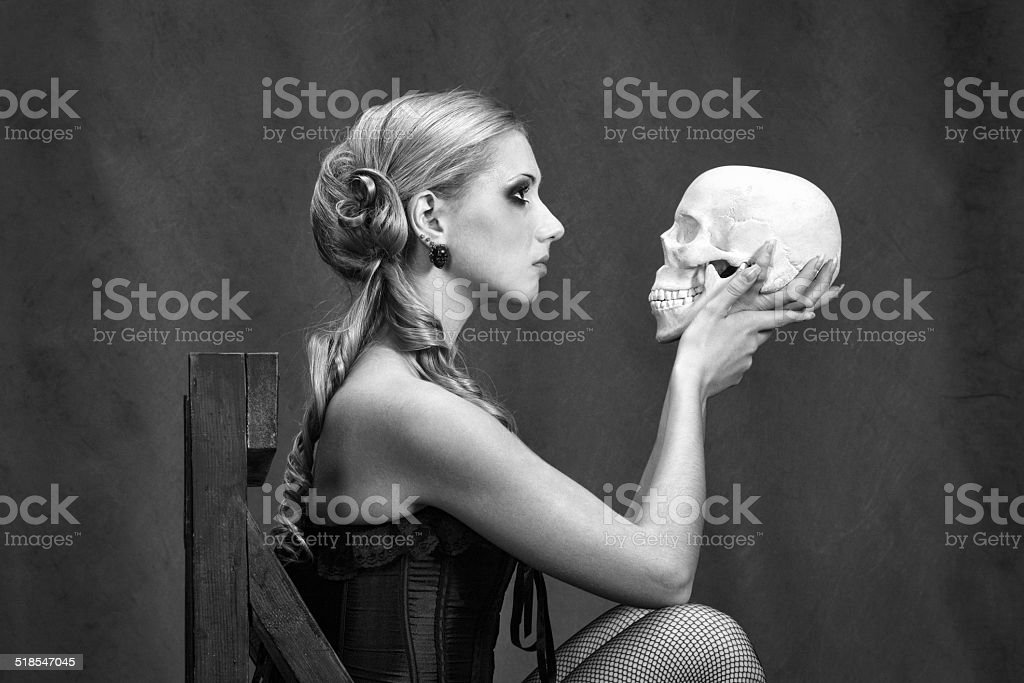 Witch with a skull stock photo