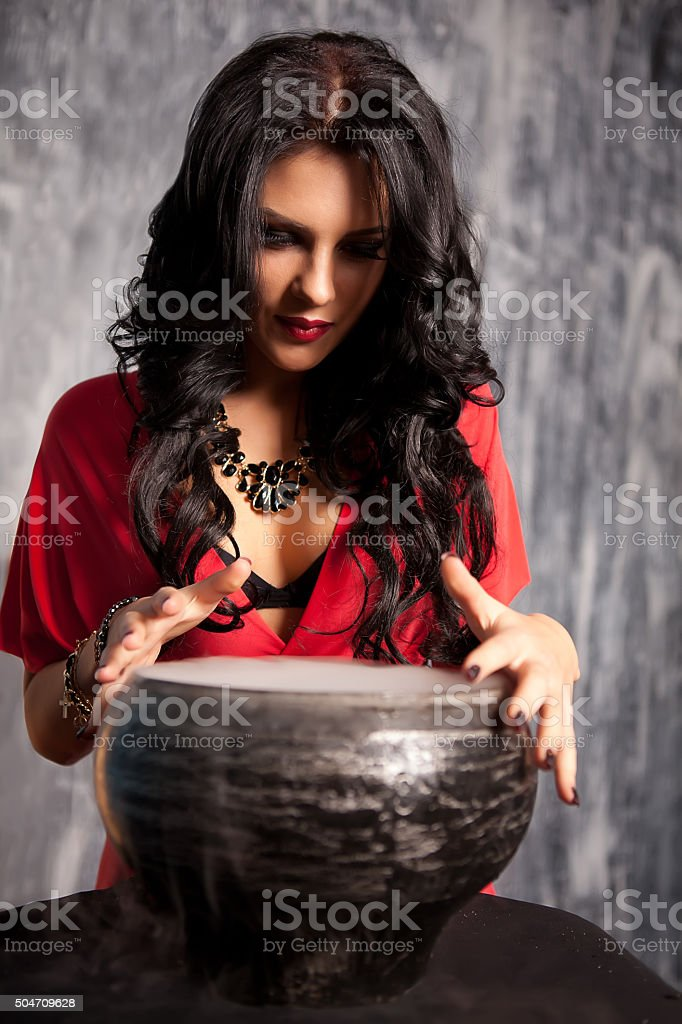 Witch with black hair stock photo
