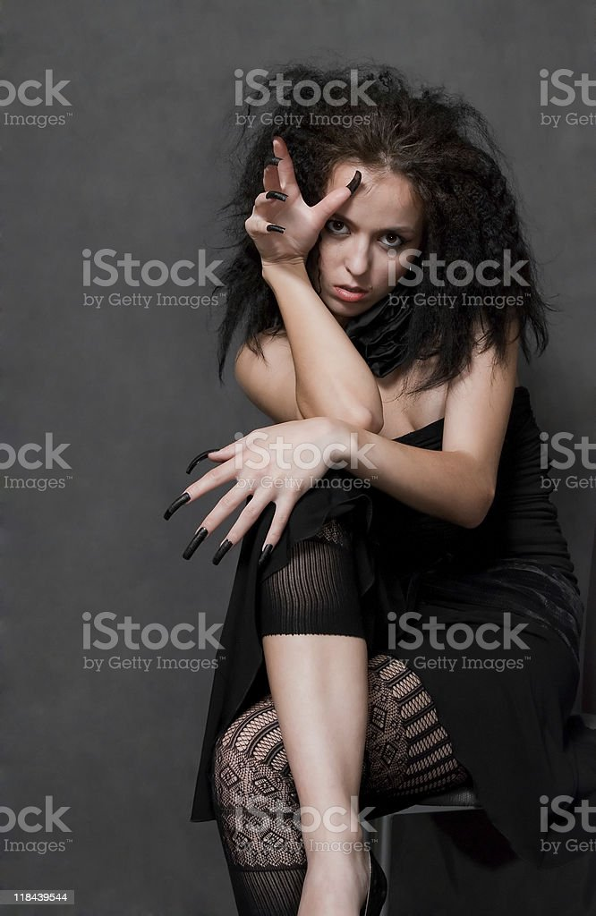 witch with black nails stock photo