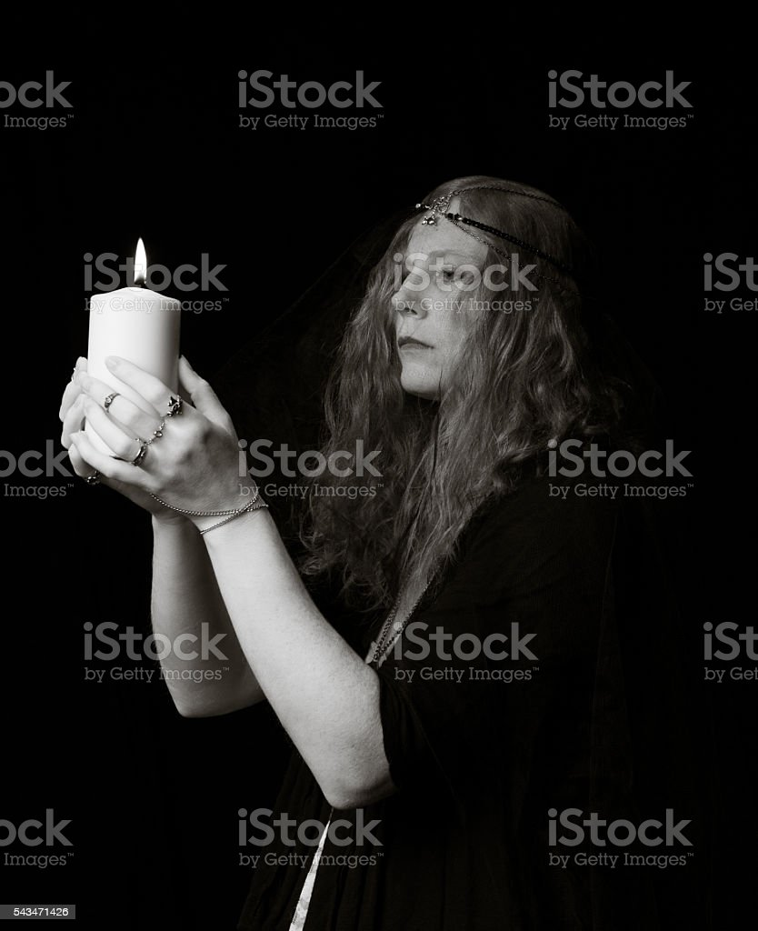 Witch with Candle stock photo