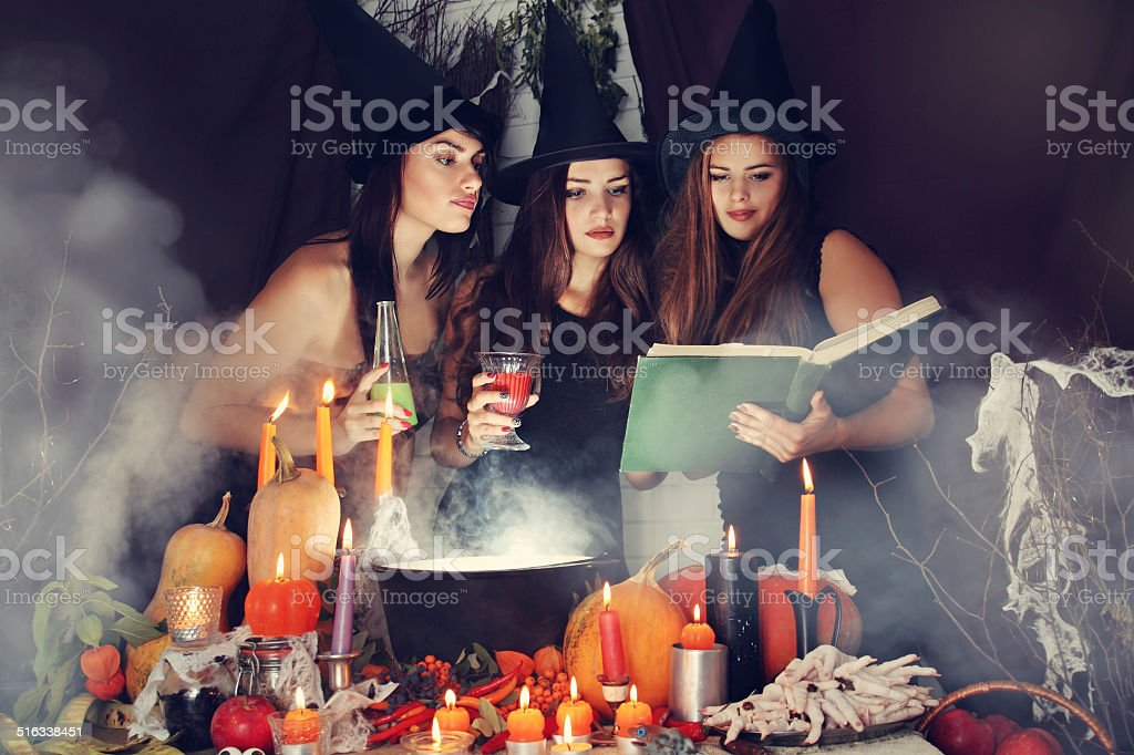 Witches look into the book, tinted stock photo