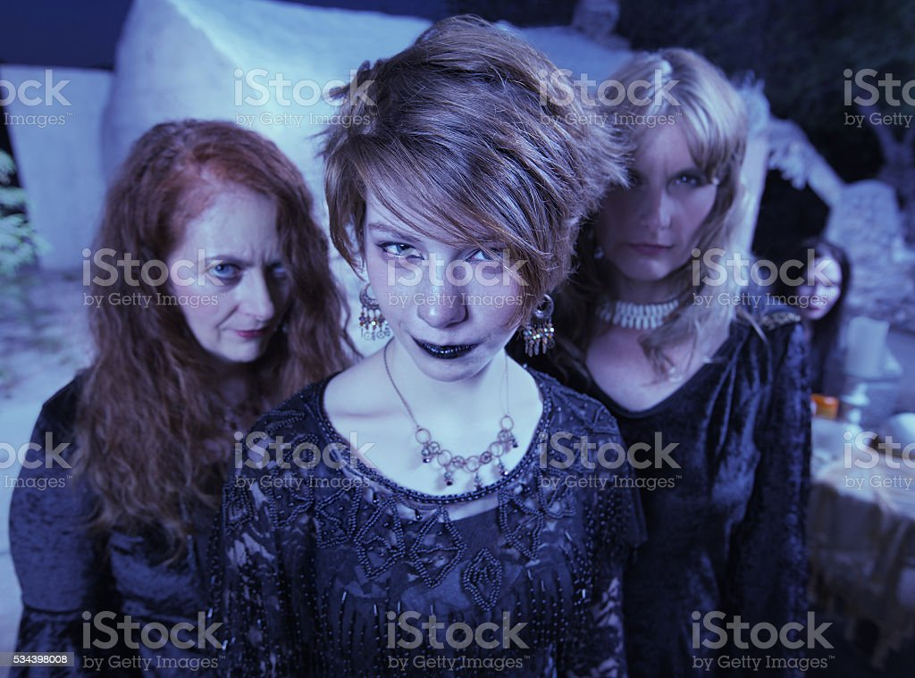 Witches Standing Outdoors stock photo