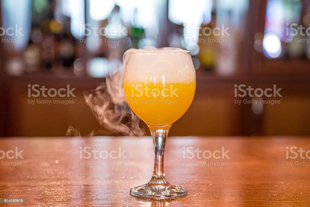 with a glass of juice is smoke stock photo