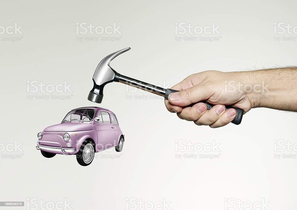 With a hammer to break the car protested, protect green royalty-free stock photo